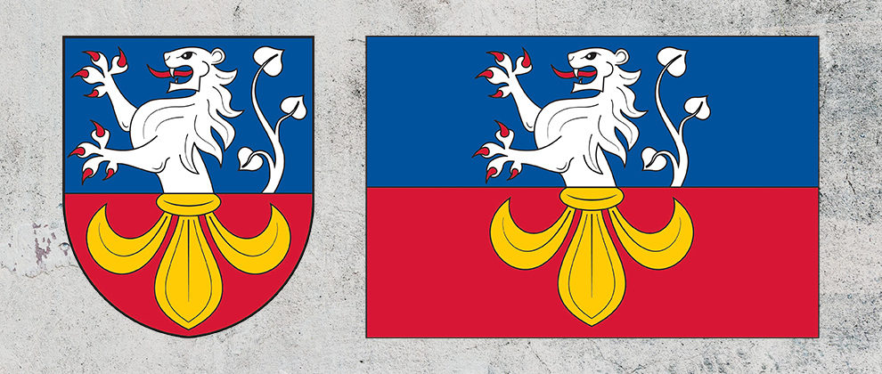 Znak a vlajka obce Hajany