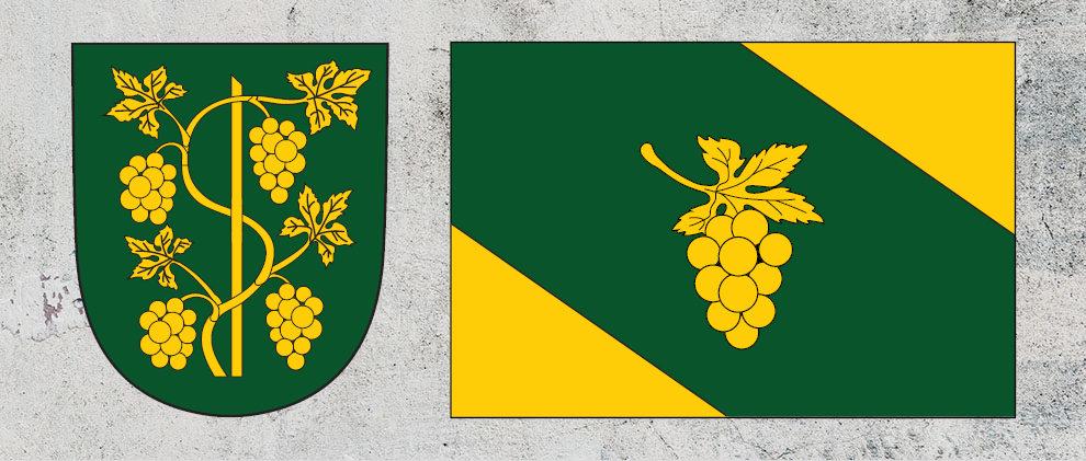 Znak a vlajka městyse Ostrovačice